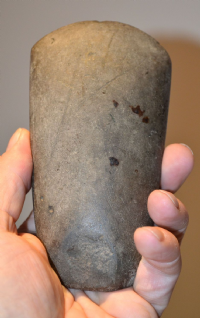 "A large, heavy and excellent Neolithic ""Langdale Tuff"" polished stone axe head from the Scottish Borders. SOLD"